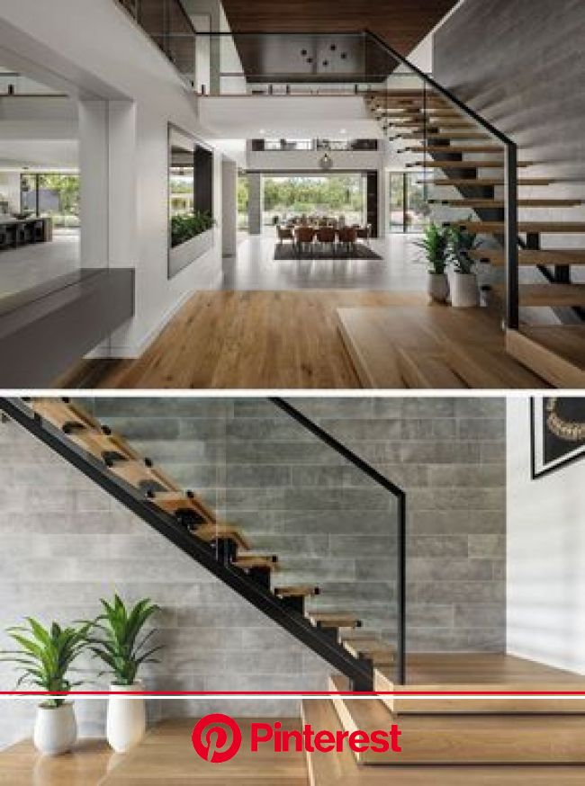 Wood stairs with a steel frame lead up to the second floor of this modern house, where t… | Stairs design interior, Home stairs design, Minimalist liv